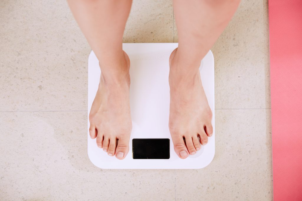 someone standing on weighing scale