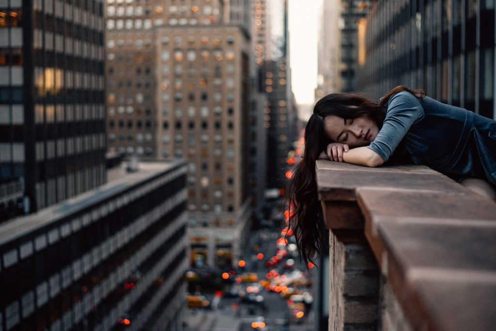 sleeping in the midst of the busy city